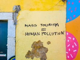 "Graffiti: Mass Tourism = Human Pollution"" (Photo by Mark de Jong on Unsplash)"