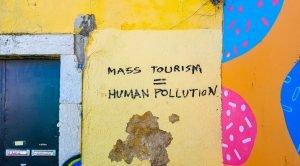 "Graffiti: Mass Tourism = Human Pollution"" (Photo by Mark de Jong on Unsplash)"