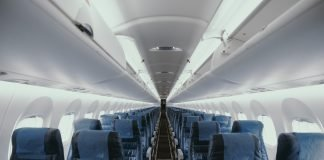 View of an empty plane - Photo by JC Gellidon on Unsplash
