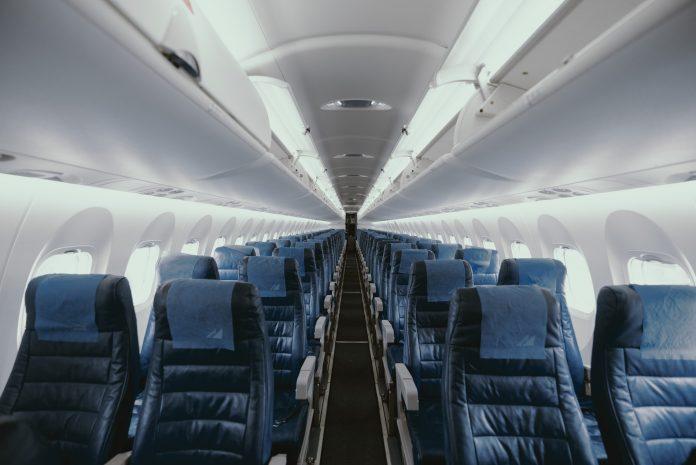 View of an empty plane - Photo by JC Gellidon on Unsplash