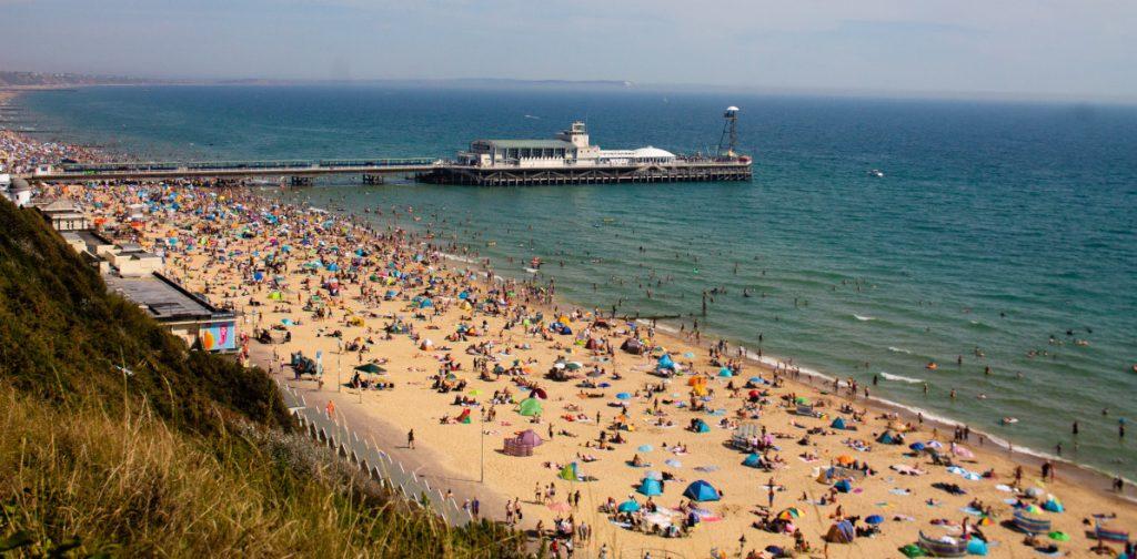 Photo of crowded Bournemouth beach by Dami Akinbode via Unsplash