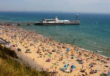 Photo of crowded Bournemouth beach by Dami Akinbode via Unsplash