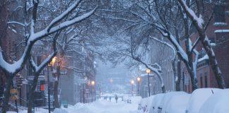 Dark, snowy night on a Montreal street. (Photo by Shawn Dearn on Unsplash).
